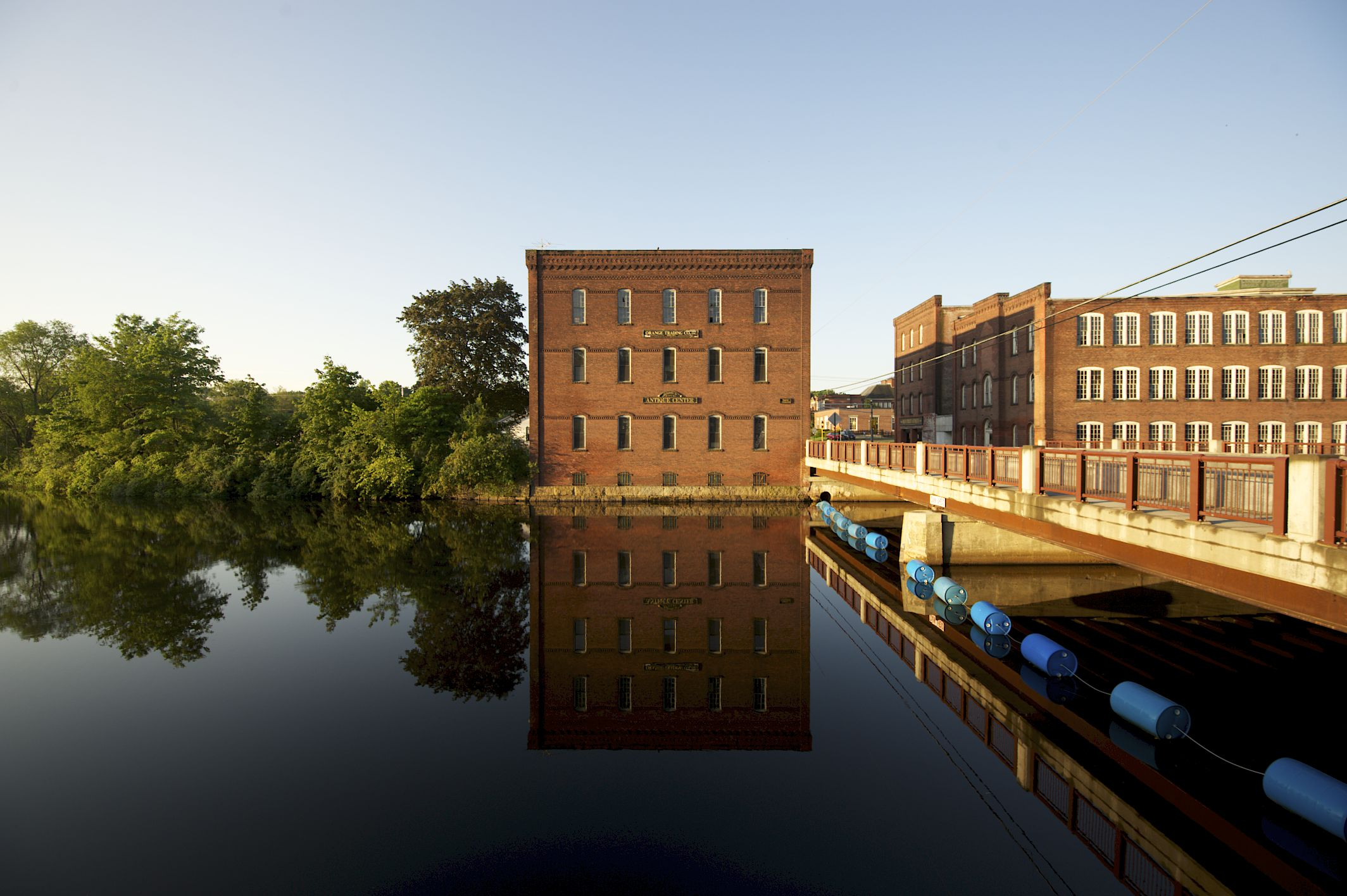 Orange MA Millers River Andrew Wertz. Building on the water with a reflection