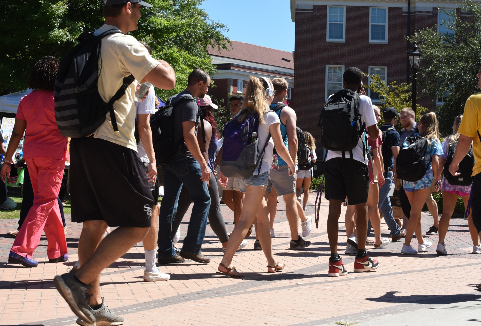Group of students walking into school, into class